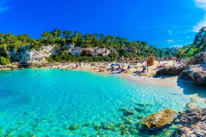 Panoramic view of Cala Llombards beach with turquoise clean wate